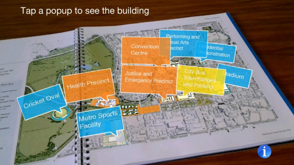Images of proposed buildings arise from a map of Christchurch, using HITLab NZ's CCDU AR app on a mobile device.