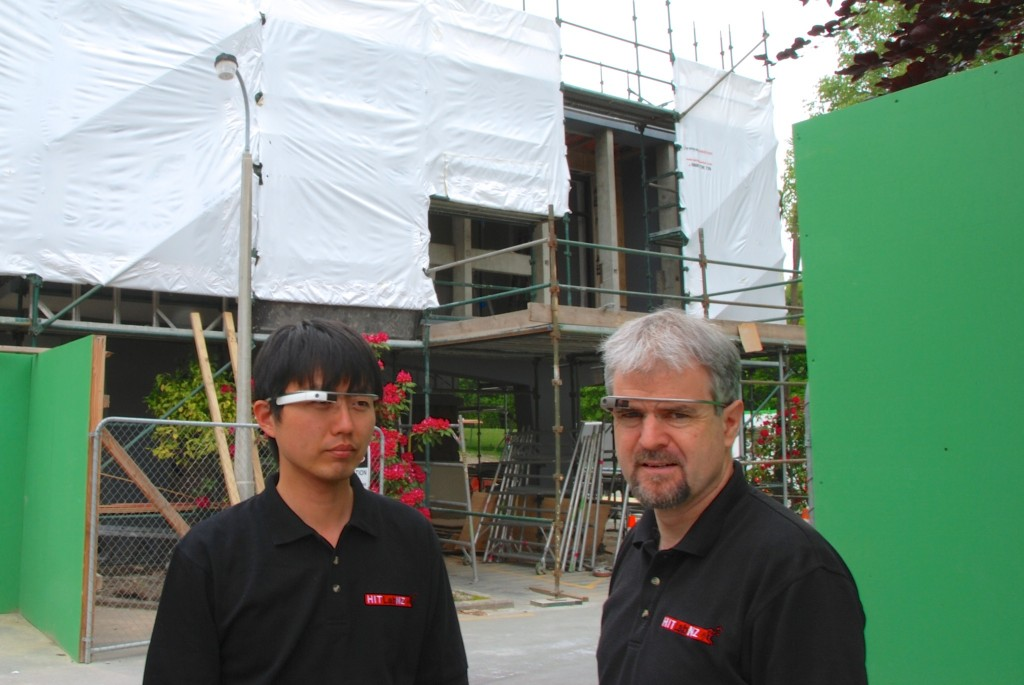 HITLab NZ's Dr Gun Lee (left) and Professor Mark Billinghurst wearing Google Glasses in post-earthquake Christchurch.